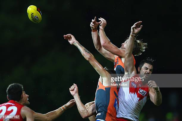 James Stewart of the Giants Rory Lobb of the Giants and Heath Grundy of the Swans compete for the ball during the 2016 AFL NAB Challenge match...