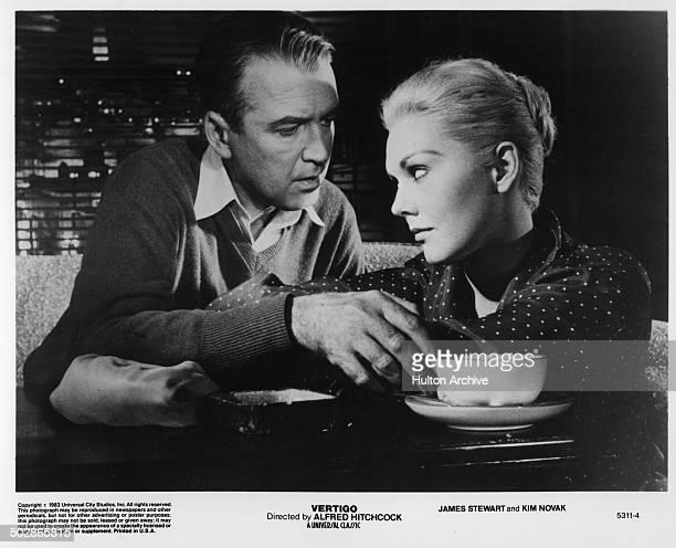 James Stewart talks to Kim Novak in a scene from the Universal movie 'Vertigo' circa 1956
