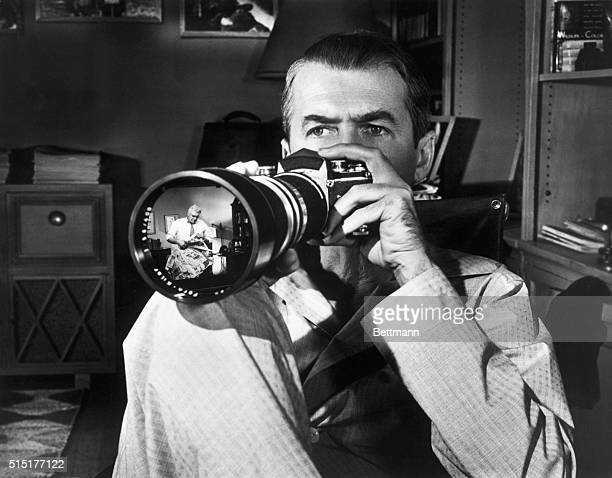James Stewart watches Raymond Burr through a camera lens in Alfred Hitchcock's 'Rear Window' Photograph BPA2# 3712