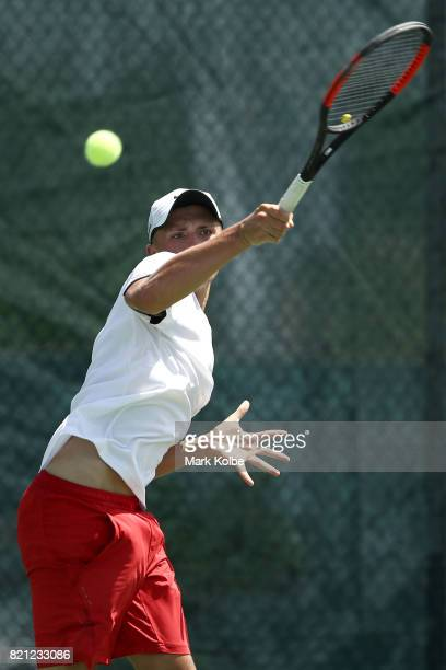 James Story of Wales competes in the Boy's Singles gold medal tennis match between James Story of Wales and Hamish Stewart of Scotland on day 6 of...