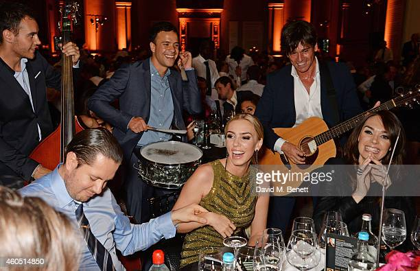 James Stunt Petra Stunt and Tamara Ecclestone listen to Didier Casnati and The Gypsy Queens at The F1 Party in aid of the Great Ormond Street...