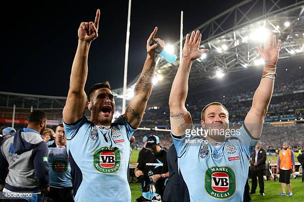 James Tamou and Trent Merrin of the Blues celebrate winning the series after game two of the State of Origin series between the New South Wales Blues...
