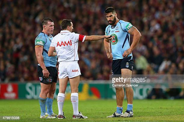 James Tamou of the Blues is placed on report during game three of the State of Origin series between the Queensland Maroons and the New South Wales...