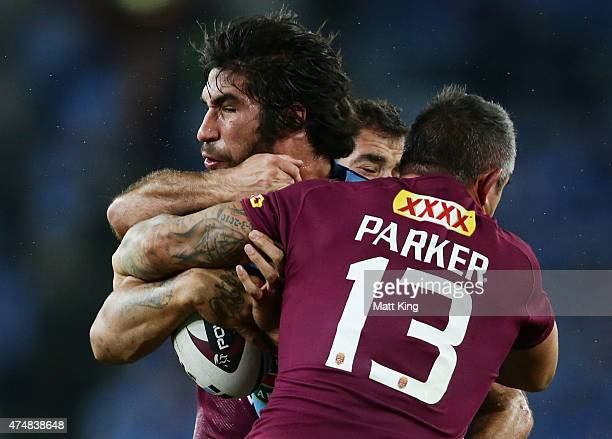 James Tamou of the Blues is tackled during game one of the State of Origin series between the New South Wales Blues and the Queensland Maroons at ANZ...
