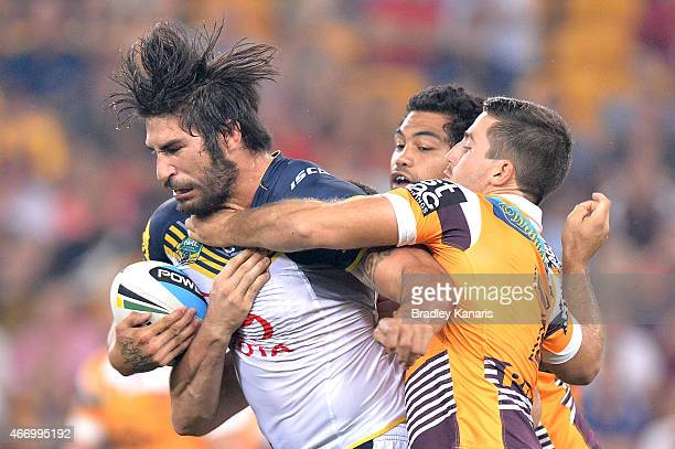 James Tamou of the Cowboys attempts to break away from the defence during the round three NRL match between the Brisbane Broncos and the North...