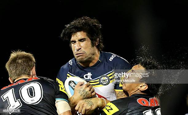 James Tamou of the Cowboys is tackled by Jeremy Latimore and Sika Manu of the Panthers during the round five NRL match between the Penrith Panthers...