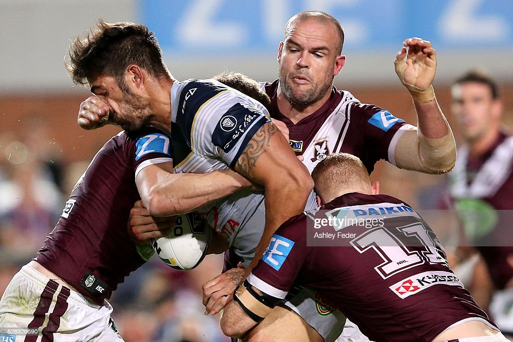 <a gi-track='captionPersonalityLinkClicked' href=/galleries/search?phrase=James+Tamou&family=editorial&specificpeople=5563889 ng-click='$event.stopPropagation()'>James Tamou</a> of the Cowboys is tackled by the Sea Eagles defence during the round nine NRL match between the Manly Sea Eagles and the North Queensland Cowboys at Brookvale Oval on April 30, 2016 in Sydney, Australia.