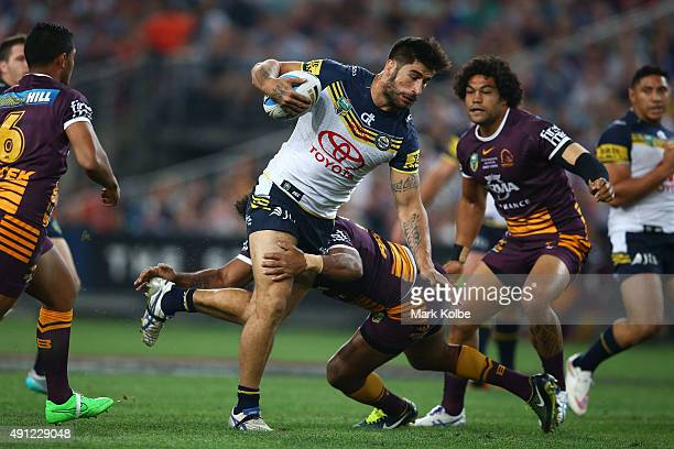 James Tamou of the Cowboys is tackled during the 2015 NRL Grand Final match between the Brisbane Broncos and the North Queensland Cowboys at ANZ...