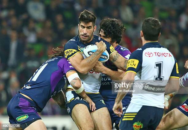 James Tamou of the Cowboys is tackled during the NRL Second Preliminary Final match between the Melbourne Storm and the North Queensland Cowboys at...