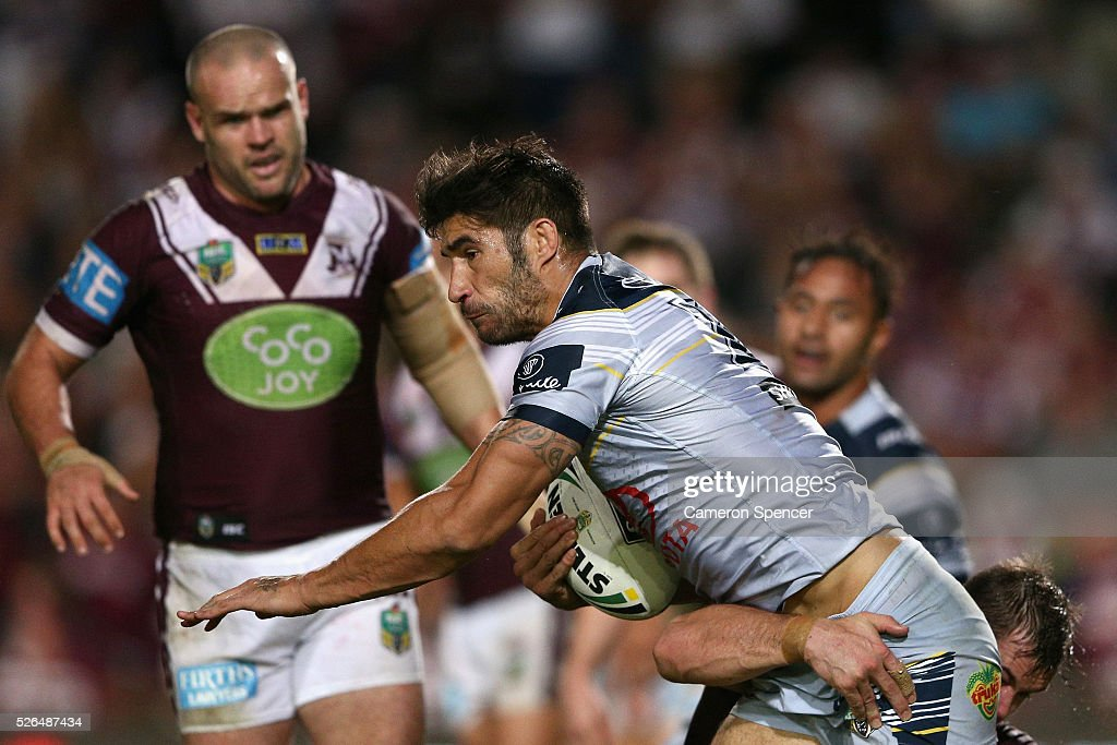 <a gi-track='captionPersonalityLinkClicked' href=/galleries/search?phrase=James+Tamou&family=editorial&specificpeople=5563889 ng-click='$event.stopPropagation()'>James Tamou</a> of the Cowboys is tackled during the round nine NRL match between the Manly Sea Eagles and the North Queensland Cowboys at Brookvale Oval on April 30, 2016 in Sydney, Australia.