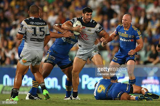 James Tamou of the Cowboys is tackled during the round two NRL match between the Parramatta Eels and the North Queensland Cowboys at Pirtek Stadium...