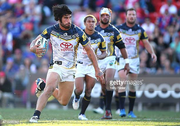 James Tamou of the Cowboys runs the ball during the round eight NRL match between the Newcastle Knights and the North Queensland Cowboys at Hunter...