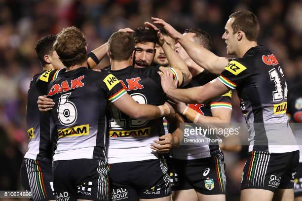 James Tamou of the Panthers celebrates with team mates after scoring a try during the round 18 NRL match between the Penrith Panthers and the Manly...