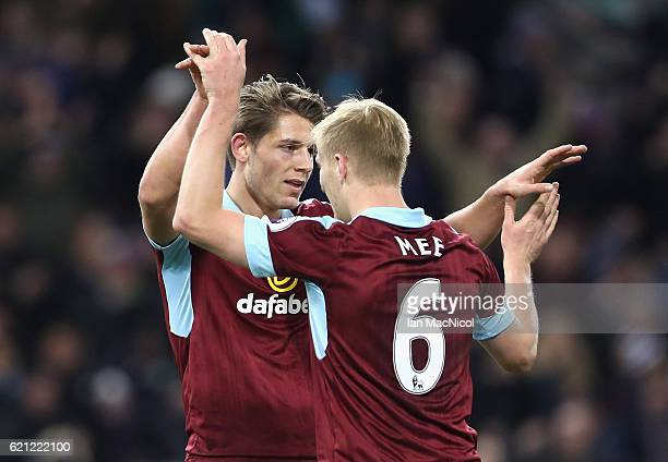 James Tarkowski of Burnley and Ben Mee of Burnley embrace during the Premier League match between Burnley and Crystal Palace at Turf Moor on November...