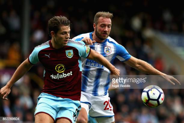 James Tarkowski of Burnley and Laurent Depoitre of Huddersfield Town compete for the ball during the Premier League match between Burnley and...