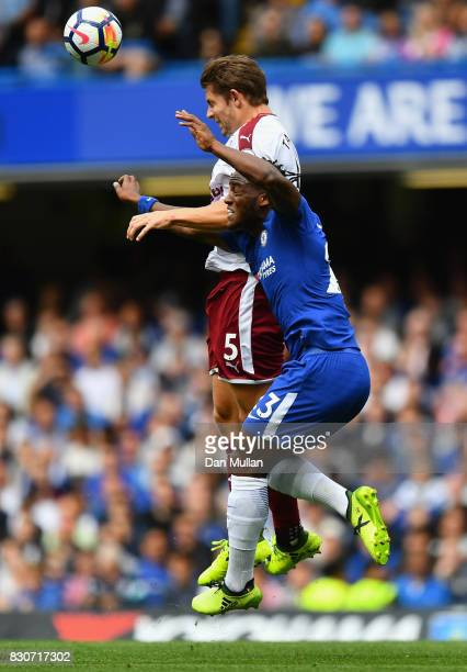 James Tarkowski of Burnley and Michy Batshuayi of Chelsea battle for possession during the Premier League match between Chelsea and Burnley at...