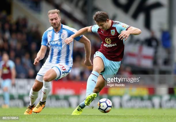 James Tarkowski of Burnley controls the ball under pressure of Laurent Depoitre of Huddersfield Town during the Premier League match between Burnley...