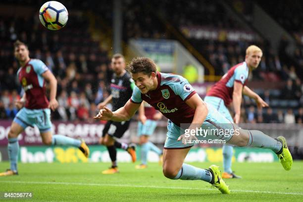 James Tarkowski of Burnley heads the ball during the Premier League match between Burnley and Crystal Palace at Turf Moor on September 10 2017 in...