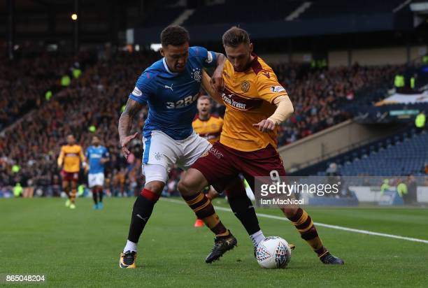 James Tavernier of Rangers vies with Louis Moult of Motherwell during the Betfred League Cup Semi Final between Rangers and Motherwell at Hampden...