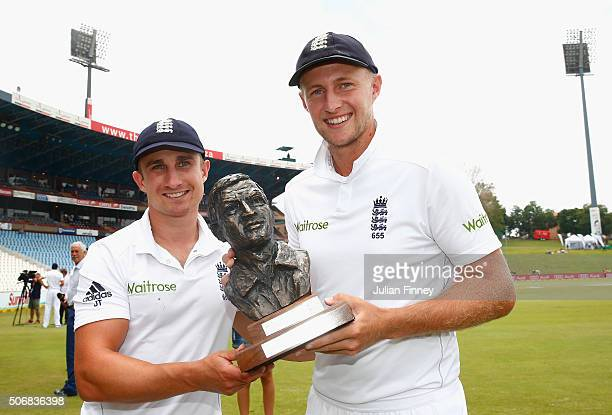 James Taylor and Joe Root of England with the Basil D'Oliveira trophy after winning the series during day five of the 4th Test at Supersport Park on...