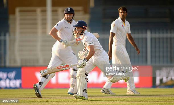 James Taylor and Jonathan Bairstow of England run between the wickets during day two of the 3rd Test between Pakistan and England at Sharjah Cricket...