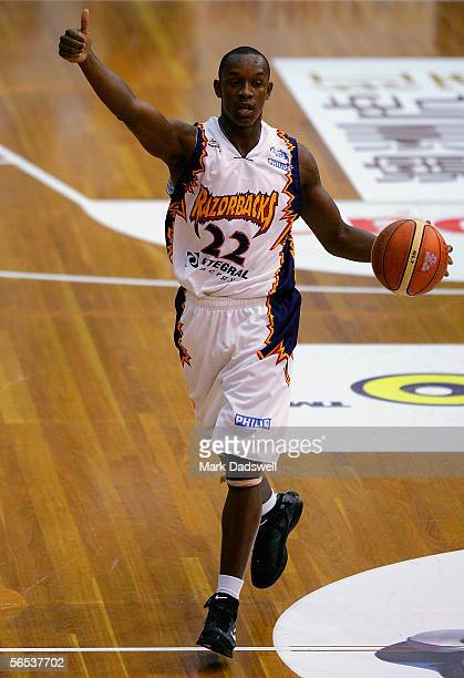 James Taylor for the Razorbacks directs his teammates during the Round 19 NBL match between the Melbourne Tigers and the West Sydney Razorbacks at...