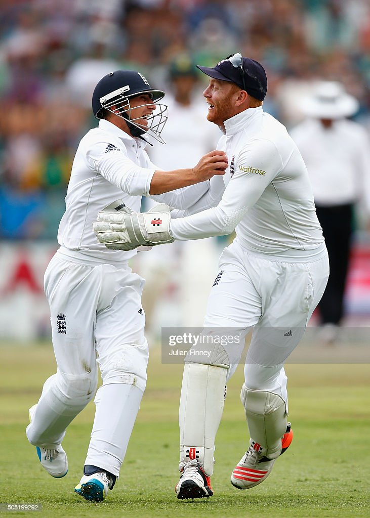 James Taylor is congratulated by Jonny Bairstow of England after he caught out Dane Vilas of South Africa off Steven Finn of England's bowling during...