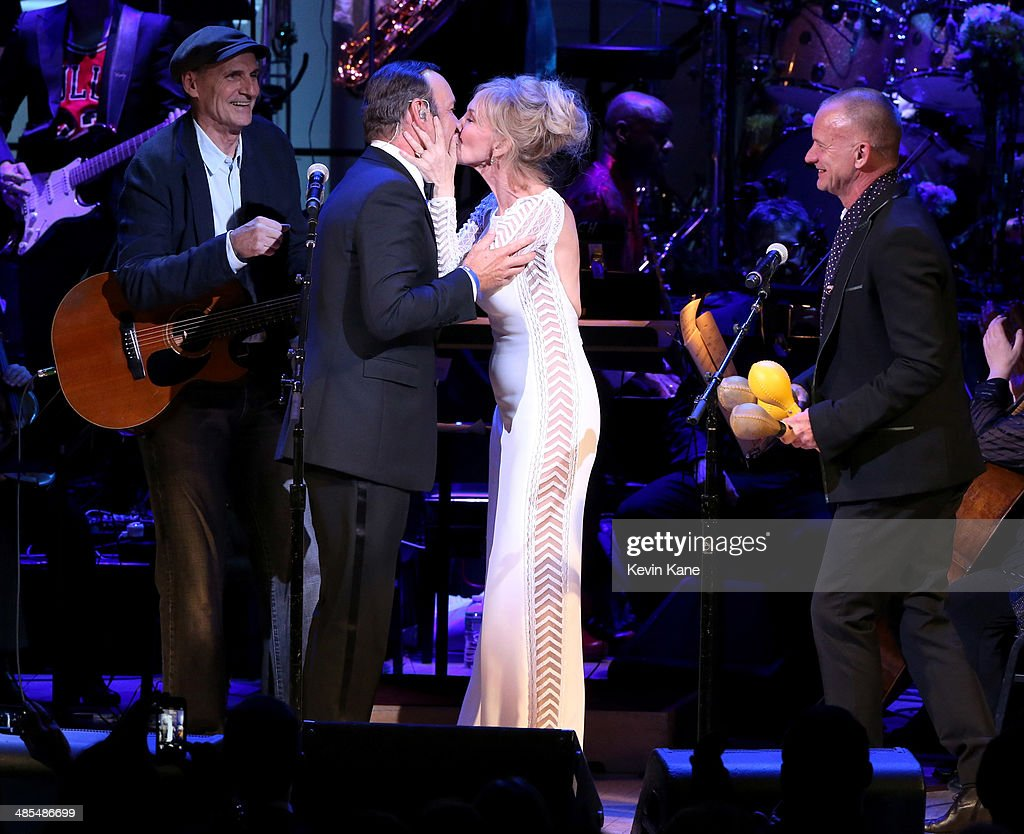 James Taylor, Kevin Spacey, Trudie Styler and Sting perform onstage during The 2014 Revlon Concert For The Rainforest Fund at Carnegie Hall on April 17, 2014 in New York City.