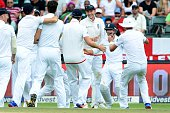 James Taylor of England celebrates the wicket of Dane Vilas of the Proteas with his team mates during day 3 of the 3rd Test match between South...