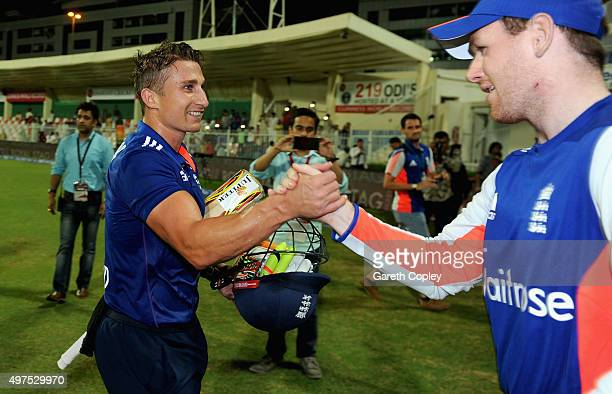 James Taylor of England celebrates with captain Eoin Morgan after winning the 3rd One Day International match between Pakistan and England at Sharjah...