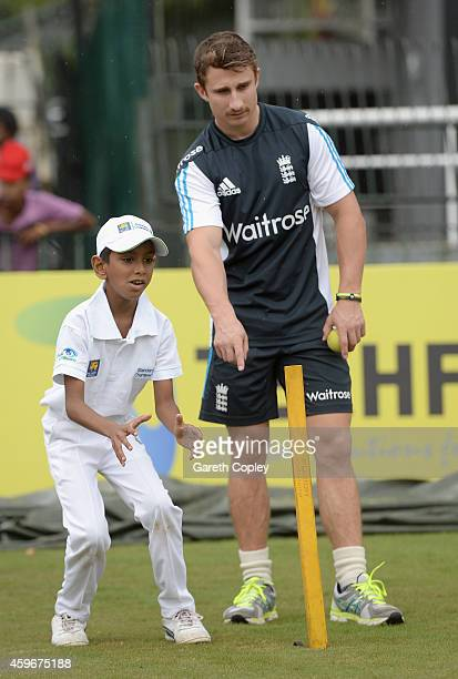 James Taylor of England coaches local children during a charity event at R Premadasa Stadium on November 28 2014 in Colombo Sri Lanka