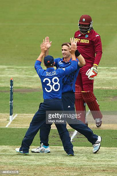 James Taylor of England congratulates Chris Woakes of England after he took the wicket of Chris Gayle of West Indies during the ICC Cricket World Cup...