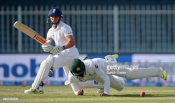 James Taylor of England hits past Azhar Ali of Pakistan during day two of the 3rd Test between Pakistan and England at Sharjah Cricket Stadium on...