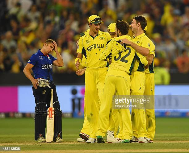 James Taylor of England looks on as Australia celebrate at the end of the 2015 ICC Cricket World Cup match between England and Australia at Melbourne...