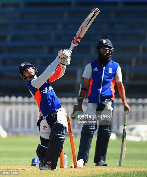 James Taylor of England plays a shot as Moeen Ali looks on during an England nets session at Basin Reserve on February 18 2015 in Wellington New...