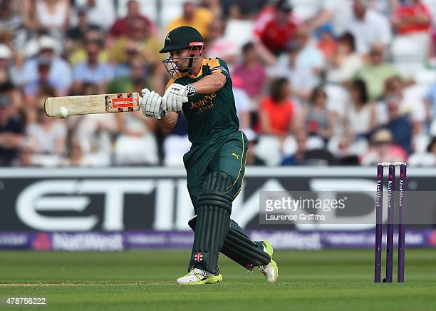 James Taylor of Nottinghamshire smashes the ball to the boundary during the NatWest T20 Blast match between Nottinghamshire Outlaws and...