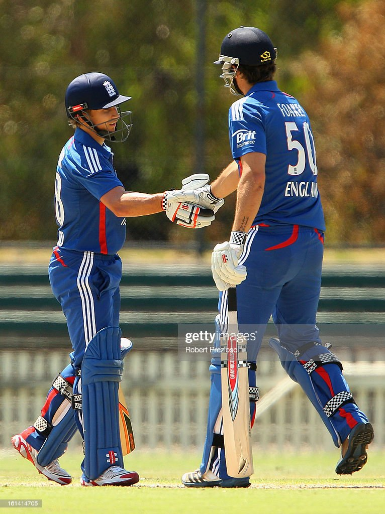 James Taylor of the Lions celebrates his century with Ben Foakes of the Lions during the International Tour match between the Victoria Bushrangers and England Lions at Junction Oval on February 11, 2013 in Melbourne, Australia.