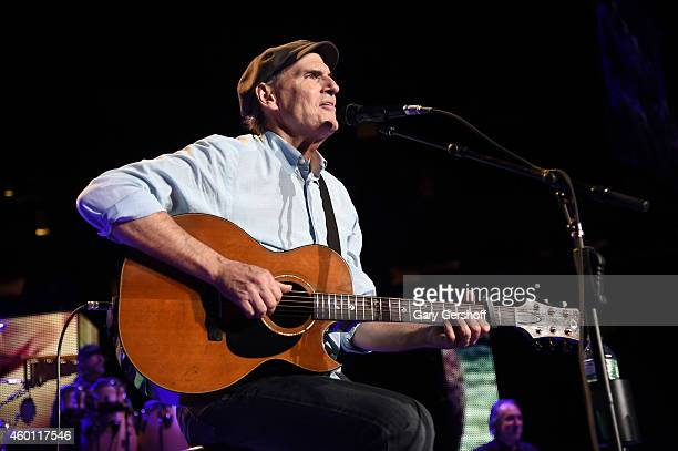 James Taylor performs onstage at Madison Square Garden on December 5 2014 in New York City