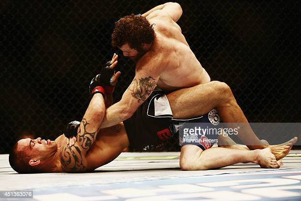 James Te Huna of New Zealand is held down by Nate Marquardt of USA during the UFC Middleweight bout between James Te Huna of New Zealand and Nate...