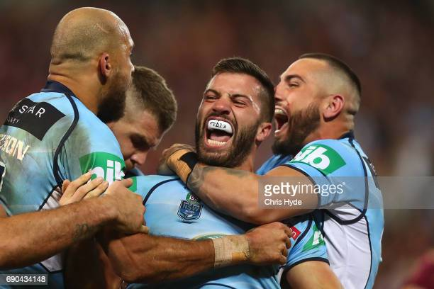 James Tedesco of the Blues celebrates a try with team mates during game one of the State Of Origin series between the Queensland Maroons and the New...