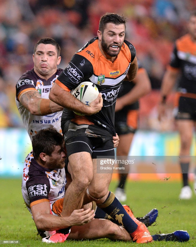 James Tedesco of the Tigers attempts to break away from the defence during the round 11 NRL match between the Brisbane Broncos and the Wests Tigers at Suncorp Stadium on May 19, 2017 in Brisbane, Australia