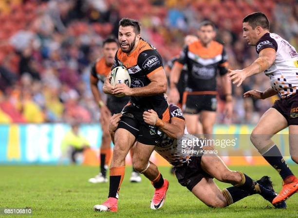 James Tedesco of the Tigers attempts to break through the defence during the round 11 NRL match between the Brisbane Broncos and the Wests Tigers at...