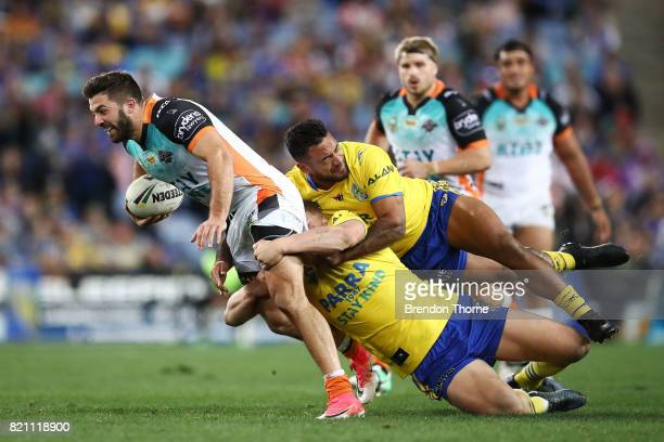 James Tedesco of the Tigers is tackled by the Eels defence during the round 20 NRL match between the Wests Tigers and the Parramatta Eels at ANZ...