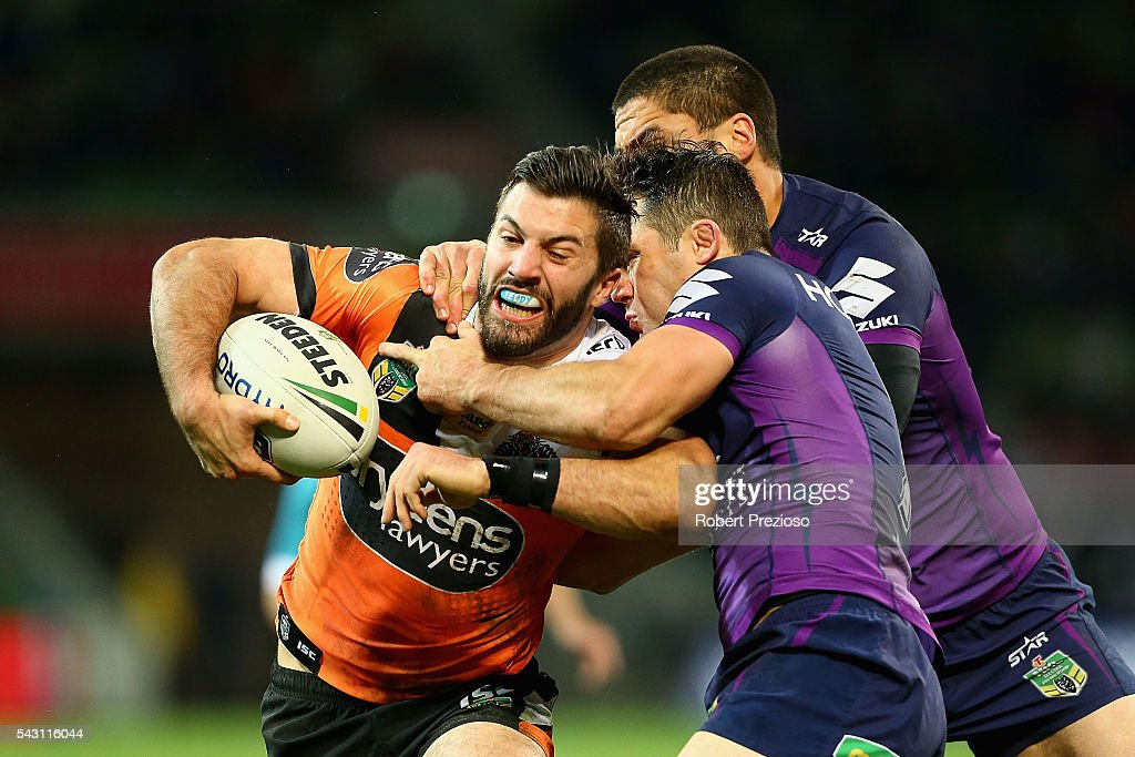James Tedesco of the Tigers is tackled during the round 16 NRL match between the Melbourne Storm and Wests Tigers at AAMI Park on June 26, 2016 in Melbourne, Australia.