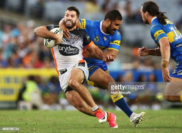 James Tedesco of the Tigers is tackled during the round seven NRL match between the Parramatta Eels and the Wests Tigers at ANZ Stadium on April 17...