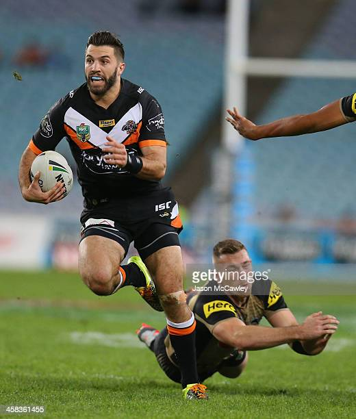 James Tedesco of the Tigers makes a break during the round 17 NRL match between the Wests Tigers and the Penrith Panthers at ANZ Stadium on July 2...