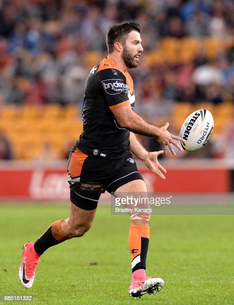 James Tedesco of the Tigers passes the ball during the round 11 NRL match between the Brisbane Broncos and the Wests Tigers at Suncorp Stadium on May...
