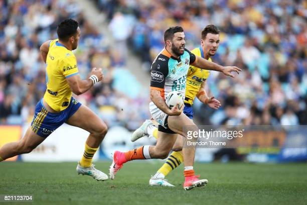 James Tedesco of the Tigers runs the ball during the round 20 NRL match between the Wests Tigers and the Parramatta Eels at ANZ Stadium on July 23...