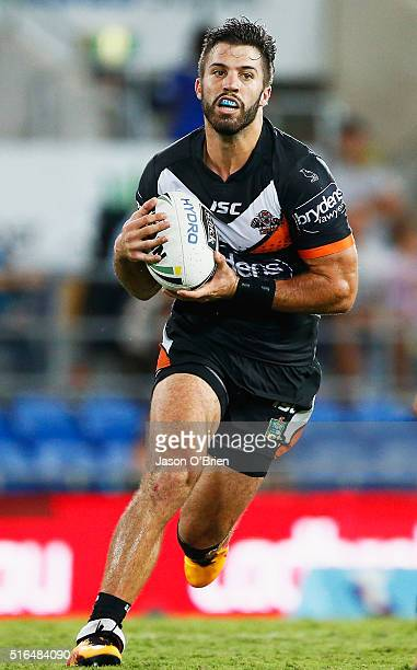 James Tedesco of the tigers runs with ball during the round three NRL match between the Gold Coast Titans and the Wests Tigers at Cbus Super Stadium...