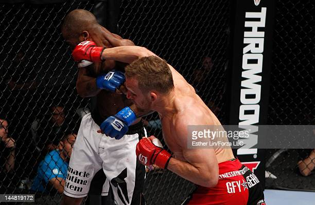 James Terry punches Bobby Green during the Strikeforce event at HP Pavilion on May 19 2012 in San Jose California
